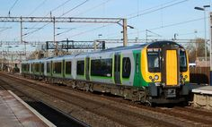Class 350  102 in London Midland livery arrives at Northampton with a London (Euston) bound train