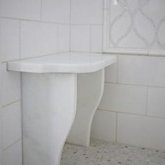 White Shower with Marble Water Jet Tiles and Small Shower Bench