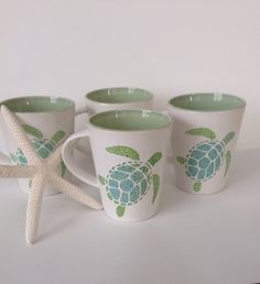 Beautiful hand painted mug with adorable sea turtle displayed in light lime green and aqua blue colors. This large 14 oz mug has a white color exterior and a light green colored inside with an artistically crackled effect on the glaze inside, making each mug unique. Perfect for yourself or as a gift. Mug stands approximately 4.25 inches tall. This ceramic mug is decorated by hand with oil-based paint pens. It is microwave safe, dish washer safe but hand washing is recommended.  After I…