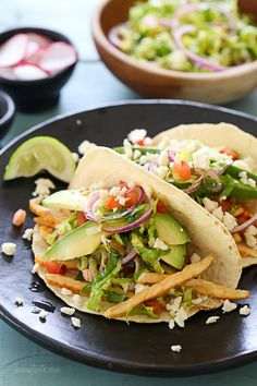 Grilled Chicken Tacos with Lettuce Slaw, Avocado and Cotija Skinnytaste.com Servings: 4 • Serving Size: 2 tacos • Old Pts: 7 • Weight Watchers Points+: 9 Calories: 326 • Fat: 16 g • Protein: 30 g • Carbs: 22 g • Fiber: 5 g • Sugar: 2 g  Sodium: 697 mg • Cholesterol: 83 mg  For the chicken:      14 oz (4 thin sliced) boneless chicken breast cutlets     1 1/4 tsp seasoned salt (I used Lawry's Fire Roasted Chili & Garlic)     1 tsp olive oil     1 tsp lime juice