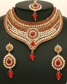 Studded designer semi bridal polki jewellery necklace set with clear and ruby stones-06SMBR20 http://www.craftandjewel.com/servlet/the-1598/Studded-designer--semi/Detail