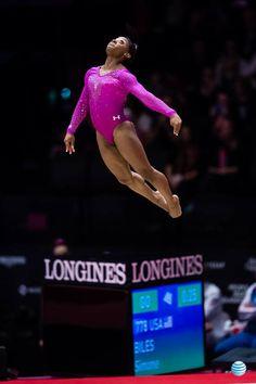 Simone Biles.  Flying.