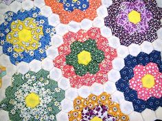 Hand pieced Grandmother's Garden quilt made by me with dime-sized hexagons. :)