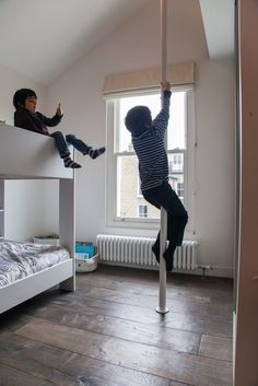 The boy's bedroom features a den in the eaves—exited via a fireman's pole.
