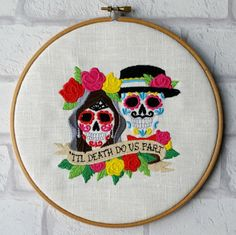 This 8 inch art hoop encases a colourful embroidery design featuring a sugar skull, Day of the dead. Til death do us part!