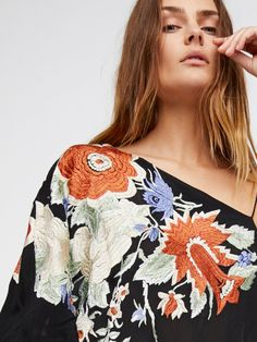 Shanti Embroidered Tunic | Sheer one shoulder tunic top featuring a beautiful and colorful embroidery detailing.    * Dramatic asymmetrical hem   * Wide short sleeve
