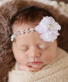 This Silver & White Rhinestone Flower Headband by The Tiny Blessings Boutique is perfect! #zulilyfinds