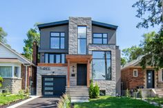 Dwarfing the houses on either side, this custom-built modern home is big, bold and beautiful. The home has lots of windows, a sleek design and pro. Airbnb House, Lots Of Windows, Modern Exterior, New Builds, Open Concept, Second Floor, New Homes, Real Estate, Cottage