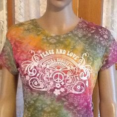"""Peace And Love Girl Scout Multi Color Top 100% light weight cotton. Bust is 36"""" and the length is 26"""". No holes, rips stains or tears. Non smoking home girl Scouts Tops"""