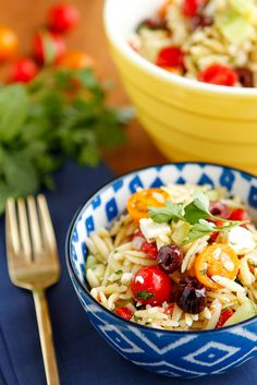Orzo Pasta Salad -- this Greek orzo pasta salad recipe is full of bright, fresh flavor... Fresh parsley and mint, along with a healthy dose of fresh lemon zest and juice, marry with cherry tomatoes, roasted red peppers, cucumber, feta cheese and Kalamata olives to make an amazing side dish that can double as a make ahead lunch for the week!