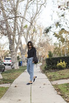 Aimee Song of the blog Song of Style dresses up light wash denim with a beaded bell sleeve top, and shares a roundup of her favorite statement sleeve tops.