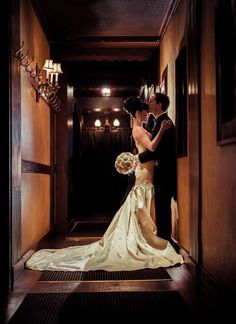 sorrento-hotel-groom-kisses-bride-forehead-hallway.jpg