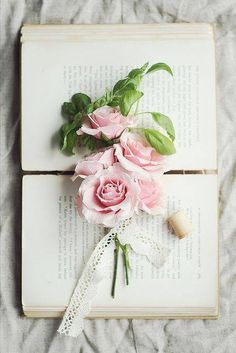 . Books and pink flowers  Pinned by Martine Sansoucy Photography  http://facebook.com/saskatoonphotography  Award winning Destination Wedding & Fashion Editorial Photographer