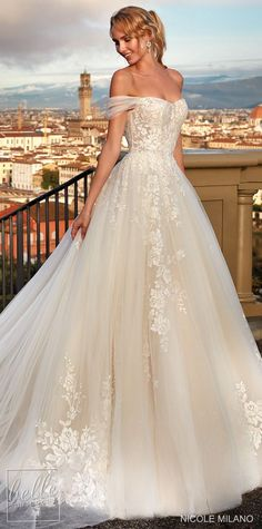 Romantic lace ballgown wedding dress style with off the shoulder strap and sweetheart neckline for the princess bride | Nicole Milano Wedding Dresses 2021 | Charming Florence Collection - Belle The Magazine #weddingdress #weddingdresses #bridalgown #bridal #bridalgowns #weddinggown #bridetobe #weddings #bride #dreamdress #bridalcollection #bridaldress #dress See more gorgeous bridal gowns by clicking on the photo