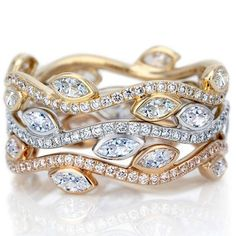 Adonis Rose Diamond band, 0.56 carat diamonds, set in platinum, yellow gold and rose gold available at De Beers Bal Harbour.