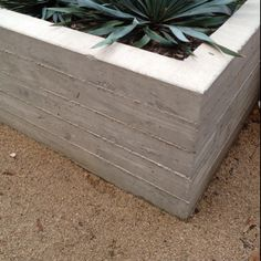 Board form concrete planter w/ crushed granite