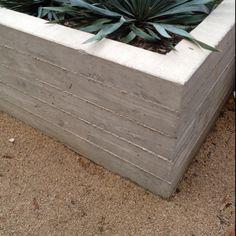 Board form concrete planter w/ crushed granite