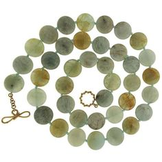 Green Aquamarine Disk Necklace ($3,995) ❤ liked on Polyvore featuring jewelry, necklaces, green, aquamarine necklace, toggle clasp necklace, knot jewelry, knot necklace and aquamarine jewelry