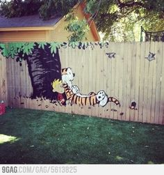 Who better than Calvin and Hobbes to add a bit of artful fun to the back yard fence...