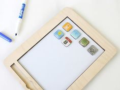 anaPad, a magnetic white board, in iPad dimensions, with an erasable marker and app-style magnets