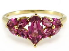 The Color of the Rhodolite Garnet is Such a Pretty Dusty Pink!  This lovely ring has .60 ct marquise cut, genuine rhodolite garnet center stone surrounded by .72 ctw marquise garnets. The setting is solid 10k yellow gold.  http://donnatsjewelry.com/Gold-Rings-Gemstone-Rings/c64_70/p4762/Marquise-Rhodolite-Garnet-Cluster-Cocktail-Ring-10k-yellow-gold/product_info.html #rhodalite and gold jewelry #colored gemstones #donnatsjewelry #black friday #cyber monday