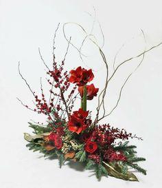 Amaryllis and tropical centerpiece. — at Avante Gardens Florist.