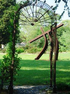 Metal arbor frames signature sculpture at the Smith-Gilbert Gardens in Georgia.