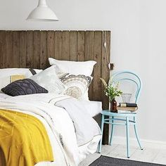 Erin Michael - bedrooms - reclaimed wood planked headboard, wood plank headboard, reclaimed wood headboard, recycled wood headboard, wood planked headboard, gray and white bedding, gray and white bed linens, gray and white pillow, charcoal gray pillow, cable knit pillow, gray cable knit pillow, mustard yellow throw, mustard yellow wool throw turquoise bentwood chair, stacked books, vase of flowers, white floors, white hardwood floors, painted hardwood floors, white painted hardwood floors…
