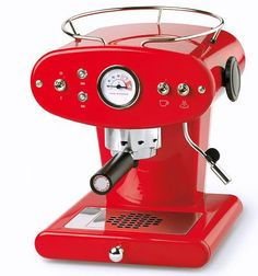 The Y1 machine is made by coffee-machine maker Francis Francis (now owned by Illy), makers of the retro-futuristic X1 espresso machine designed by Italian architect Luca Trazzi in the late 1990s.