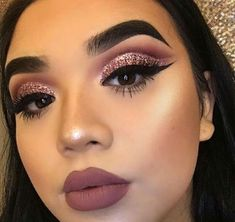 Mauve pink lips with a pop of glitter will glam up any makeup look!