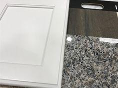 White Cabinets New Caledonia Granite And Domingo Laminate Flooring Caledonia Granite Kitchen Countertops House Flooring
