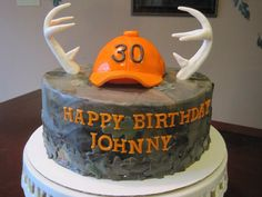 Camo birthday cake with fondant deer antlers and orange hunting hat