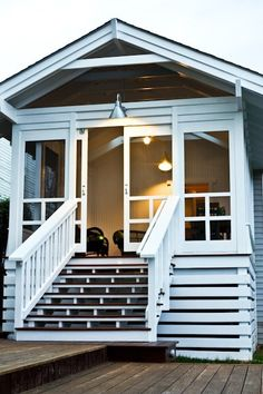 screened in porch using barn-style screen doors!  (no instructions, just pinned for the inspiration)