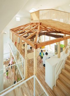 MAD transforms Japanese house into curvaceous kindergarten with a slide along one wall.