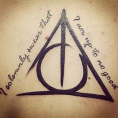 Deathly Hallows Tattoo. I like the brush strokes of the symbol.