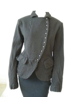 Norio Nakanishi's Jacket with rounded rever. Fastener with metal buttons with stalk. Price: $456.00