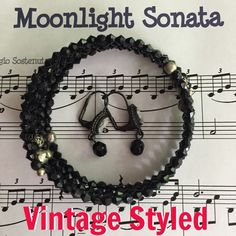 "Period Styled Bracelet & Earrings Gorgeous Cameo earrings look perfectly vintage. The hand beaded (by moi) mem-wire bracelet has black bi-cone beads, silver rose beads & silver spacer beads. Memory wire runs smaller than most. I would say a 7-8"" wrist. Jewelry Bracelets"