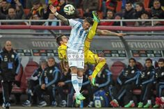 Romania's Alexandru Matel (L) fight for the ball with Argentina's Marcos Rojo during the friendly soccer match at National Arena stadium, in Bucharest, Romania, 5 March 2014. The match ended 0-0.