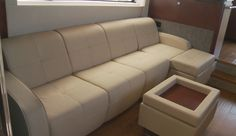 Sea Ray 510 Fly: We can attest to the fact that this sofa on the port side of the salon is as comfortable as it looks. A hide-a-bed is an option. The ottoman is optional and we highly recommend it as it converts from a coffee table to sitting stool.