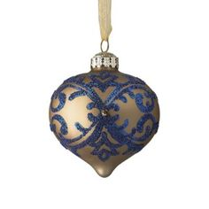Crisp elegance. The curated French Linen and Blue Ornament Accent Kit of mouth blown, hand-painted glass ornaments seamlessly blends classic and contemporary designs, illustrated in tones of azure, twilight, linen and cream. Ornaments in ginger jar shapes feature traditional blue-and-white ware patterns. Hand-decorated, hand-painted, mouth-blown glass Spot clean only