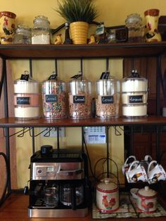 Bakers rack with clear plastic jars labeled with chalkboard & burlap. Set up…