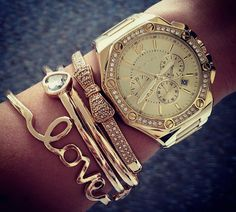 When stacking bracelets stick to using the same type of precious metal or gem throughout. Heres a stacking of gold bracelets teamed with a gold watch. Simple, classic yet girly look.