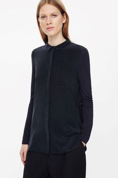 This long shirt is made from a stretchy woven material with a mulberry silk front panel. A straight fit, it has a neat narrow collar, a single patch pocket, graduated hemline and hidden button fastenings.