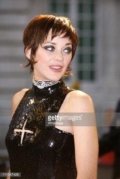 Marion Cotillard wearing pixie cut with long sideburns and nape sections