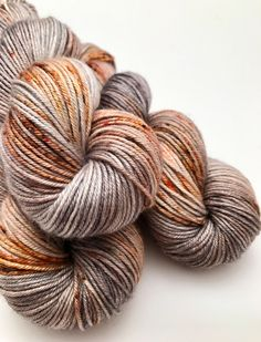 A personal favorite from my Etsy shop https://www.etsy.com/ca/listing/488527443/hand-dyed-yarn-grey-orange-brown-rust