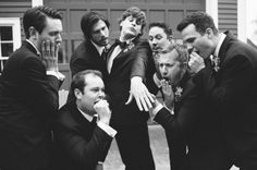 pic of the groom showing off his ring while the groomsmen act excited + amazed :) this shot is a MUST