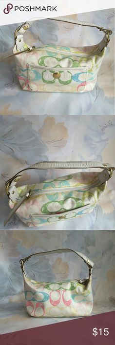 "Coach small handbag Coach Small Multicolor Canvas Handbag.   Good condition and clean.   Length 8.5"" height 5"" width 3"" strap drop 5""  Features; zipper closure and front slip pocket   Smoking and pet free home. Coach Bags Mini Bags"
