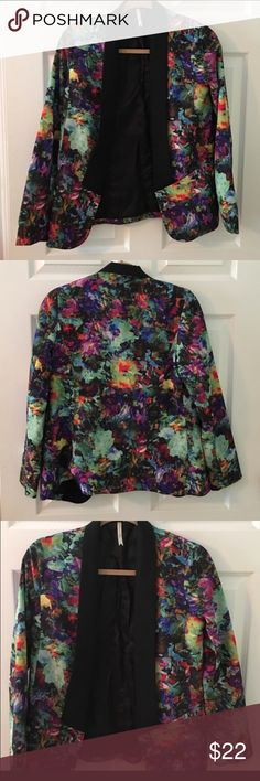 "Beautiful floral Petticoat Alley Blazer Size small. In excellent condition. Petticoat Alley brand. Multi-color floral Blazer. No stains or tears. Bust measures 18"" and length measures 26"". Smoke free home. Shell is 100% polyester and lining is 60% Viscose and 40% polyester. petticoat alley Jackets & Coats Blazers"