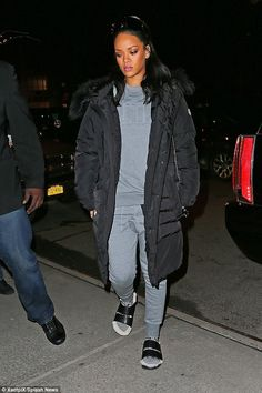 Rihanna New York City March 15, 2015 | Rihanna wearing Celine Spring 2013 Sandals, Dior Diorama Bag, Rick Owens Large Lens Shield Sunglasses, Puma Evolution Sweater, Puma Cargo Sweat Pants, Married to the Mob Bitch Sticker Socks, Delfina Delettrez 18k Yellow Gold Ring with White Pearl Topaz and Diamond, Moncler Dylan Belted Down Coat and Givenchy Seventeen Shield Sunglasses
