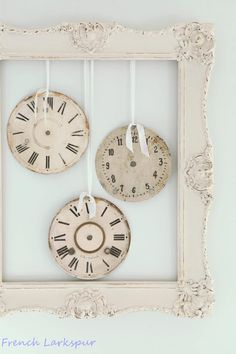 Shades of white & beige clock faces in frame Shabby Chic